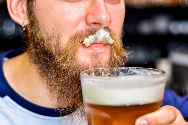 beer on man's mustache | 10 Health Benefits of Drinking Beer To Shut the Health Nut Up