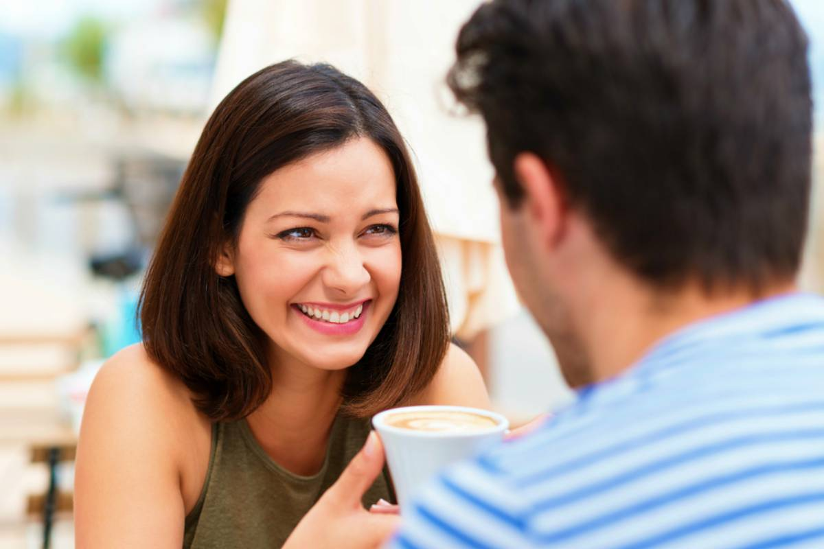 happy couple having great time talking over coffee date pick up lines   Funny and Cheesy Pick Up Lines To Make Her Smile (And Land You A Date)