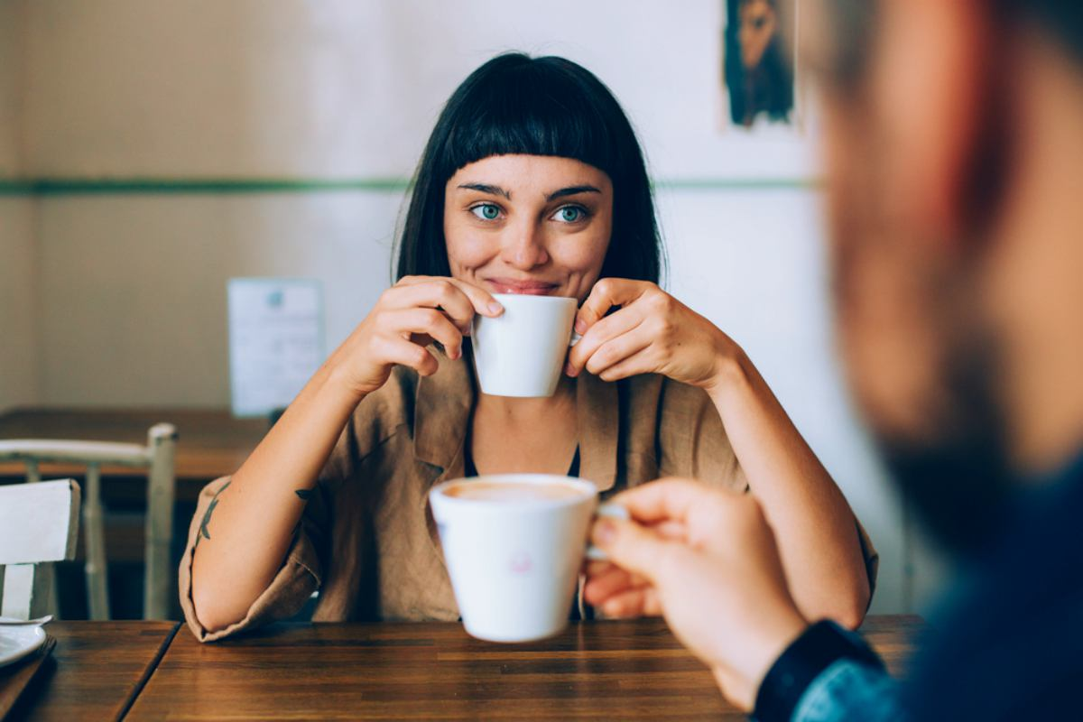 woman smiling on a coffee date   woman smiling outdoor   happy couple having great time talking over coffee date pick up lines   Funny and Cheesy Pick Up Lines To Make Her Smile (And Land You A Date)