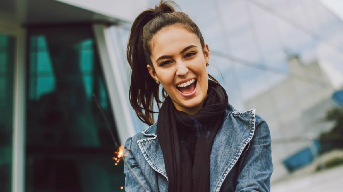 woman smiling outdoor   happy couple having great time talking over coffee date pick up lines   Funny and Cheesy Pick Up Lines To Make Her Smile (And Land You A Date)